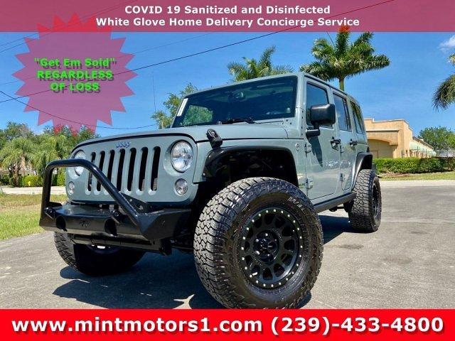 1c4bjweg3el189604-2014-jeep-wrangler-unlimited-sahara-used-convertible-fort-myers-fl
